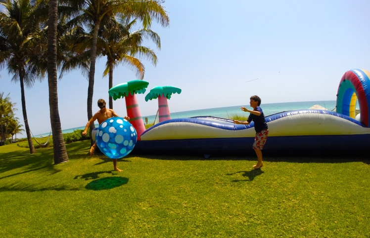 Aquassurance lifeguard, Damian, entertaining children before a Golden Beach pool party.