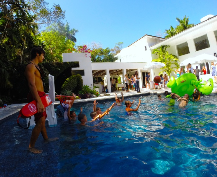 Aquassurance Lifeguard, Damian, watching over a game of basketball at a Pinecrest pool party.