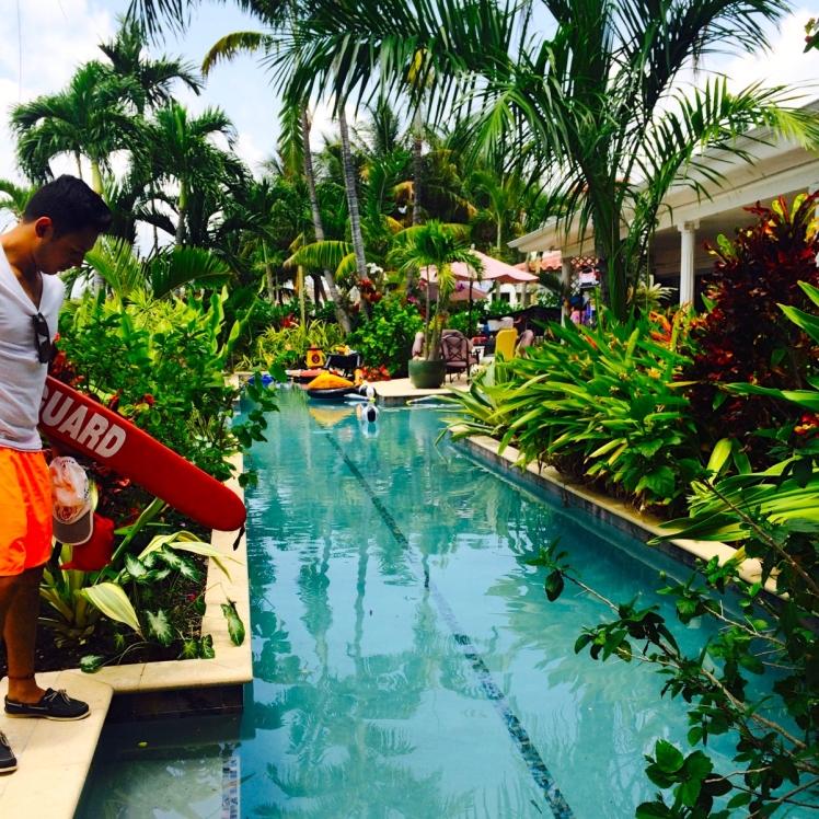 Ernesto lifeguarding at a beautiful Miami pool party.